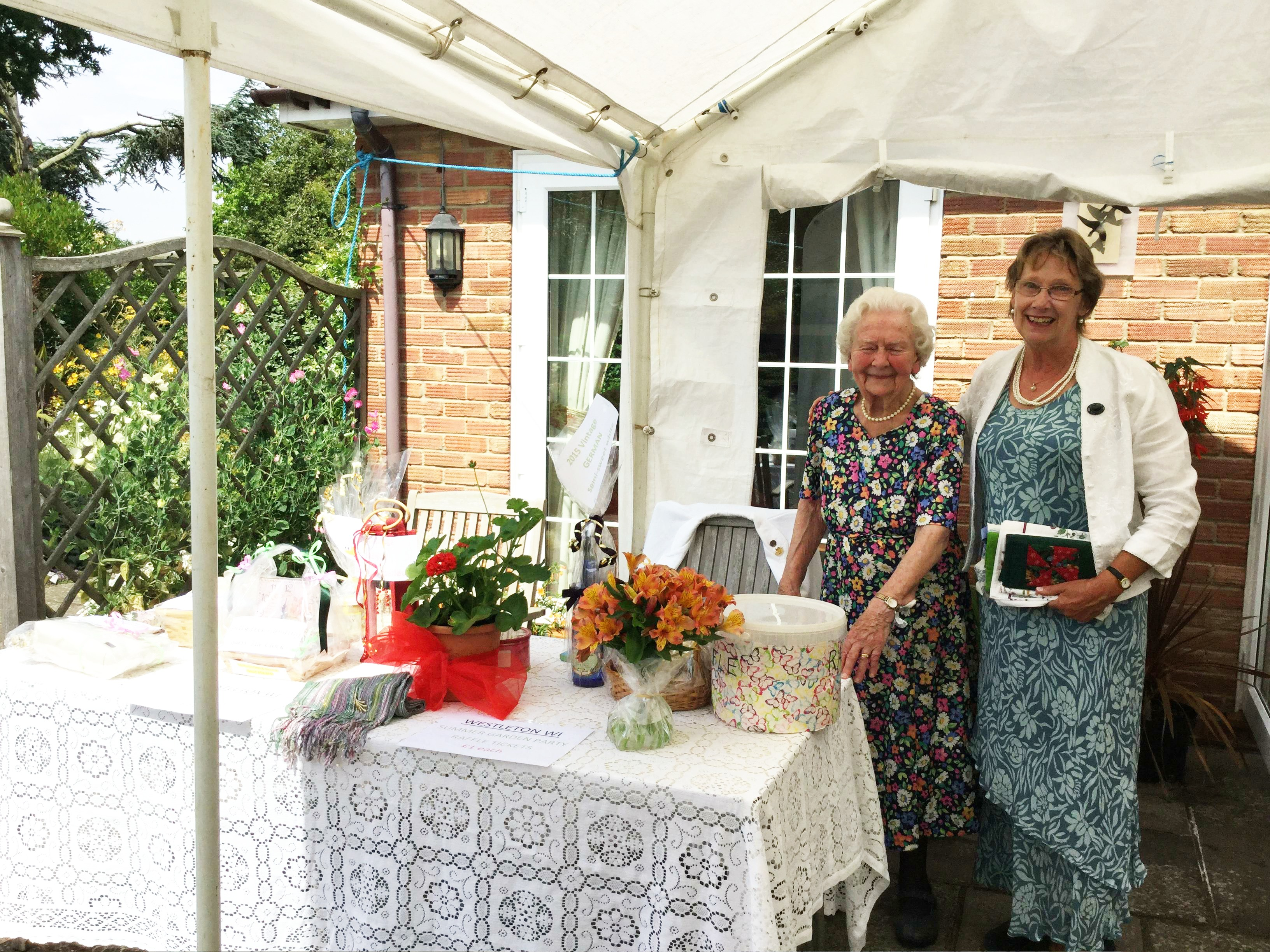 Pimms, Raffle and a Quiz in President Pat Swindell's garden. Monica and Mary at the  table.