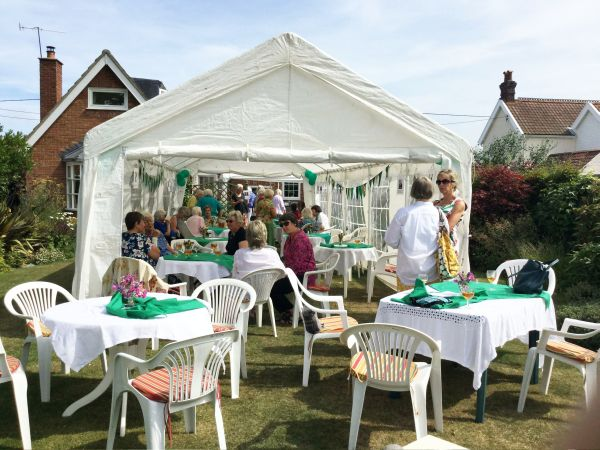 Pimms, Raffle and a Quiz in President Pat Swindell's garden. View of marquee and members.