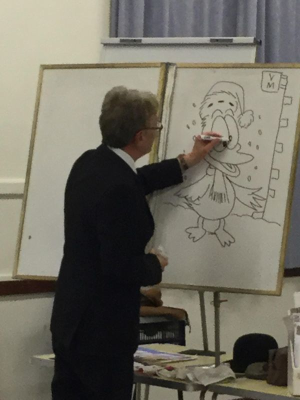 The speaker drawing the cartoon duck