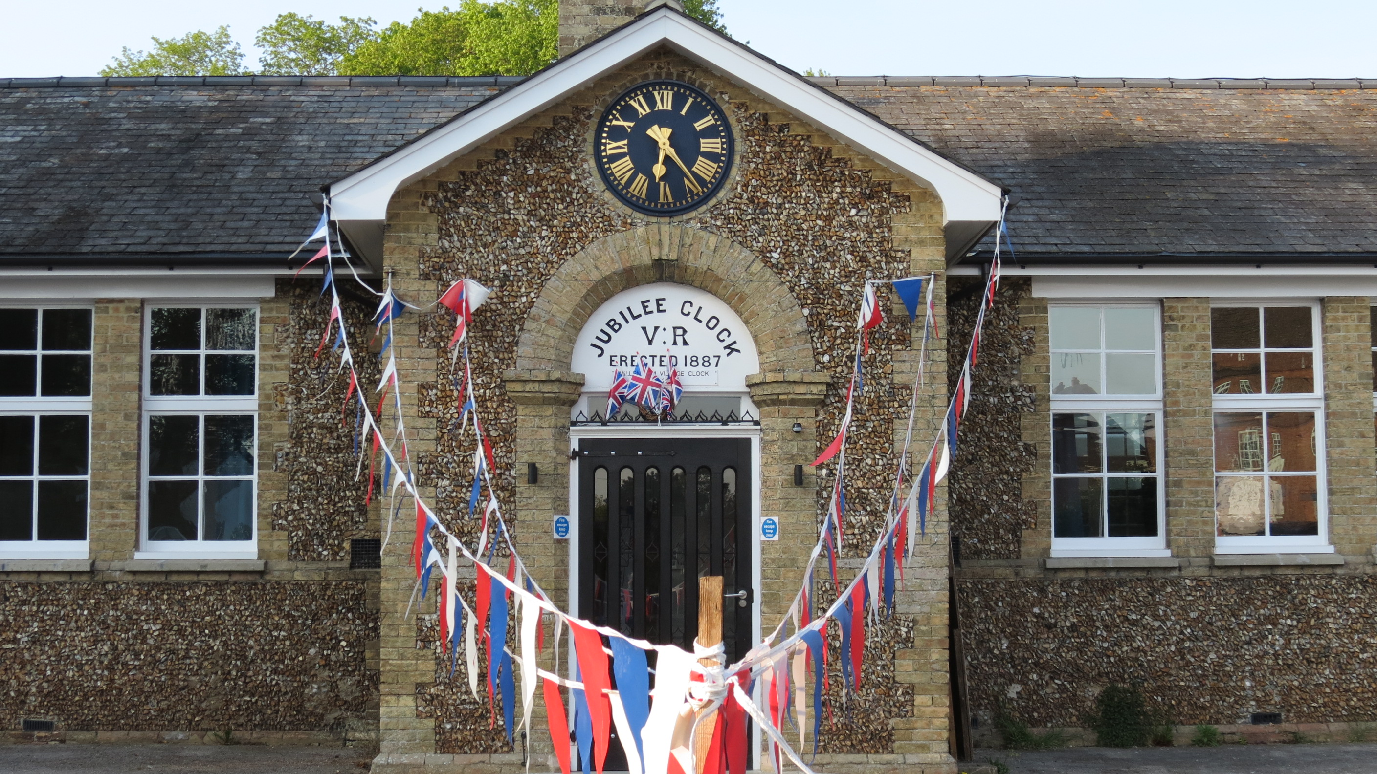 Westleton Village Hall from the front showing red, white and blue bunting.