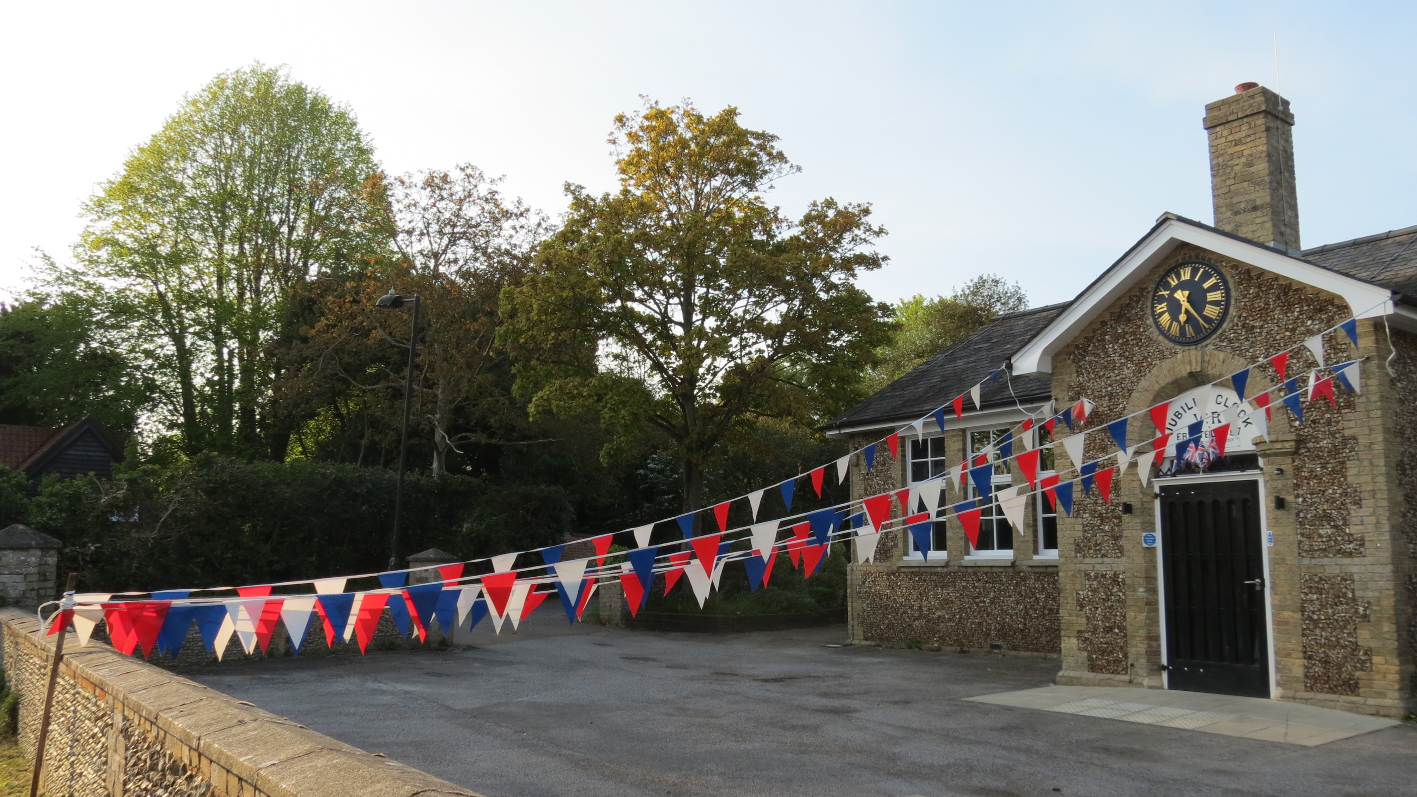 Westleton Village Hall from The Street showing red, white and blue bunting.