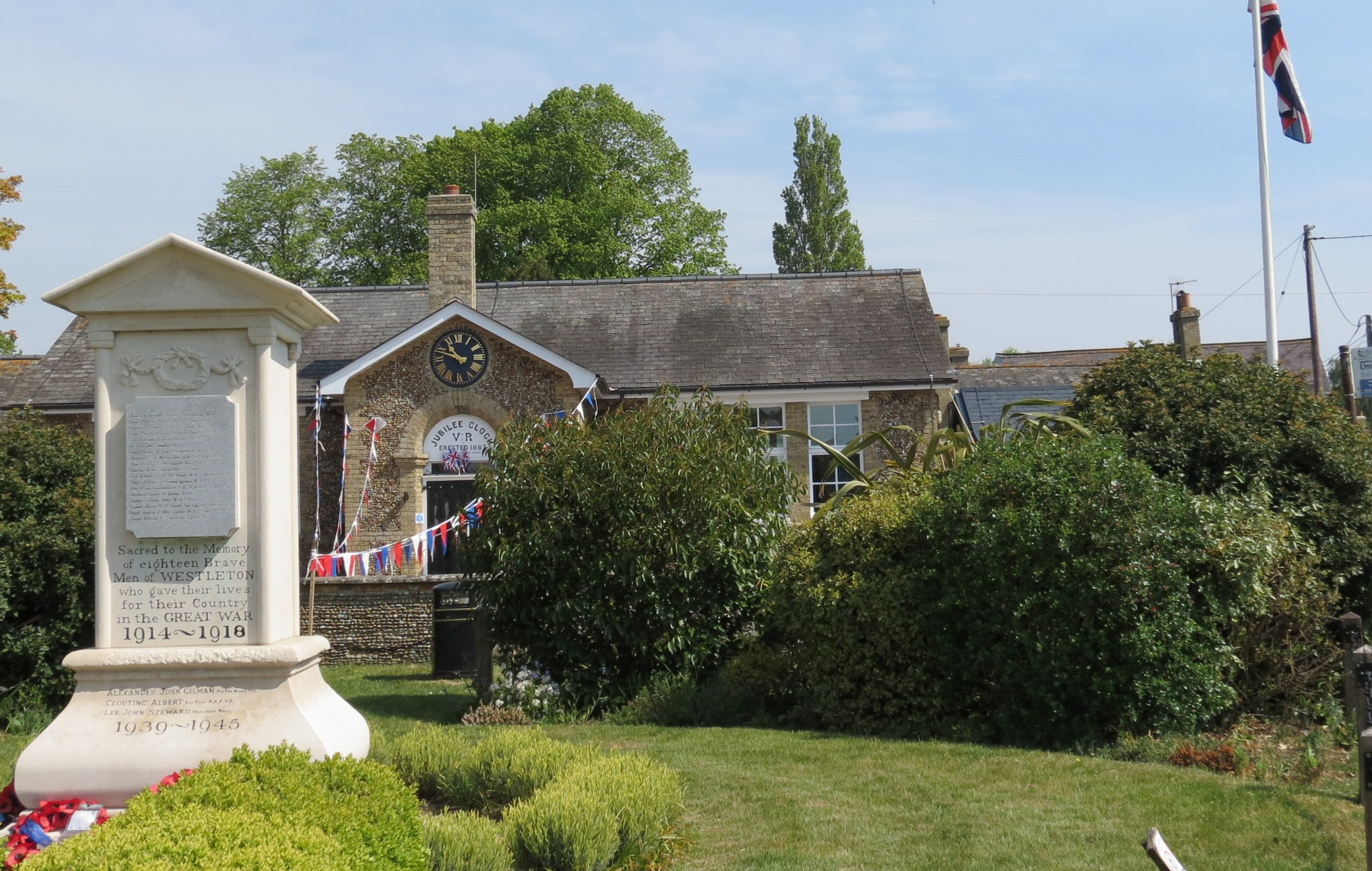 Westleton Village Hall from front, again, showing War memorial and VE Day decorations.