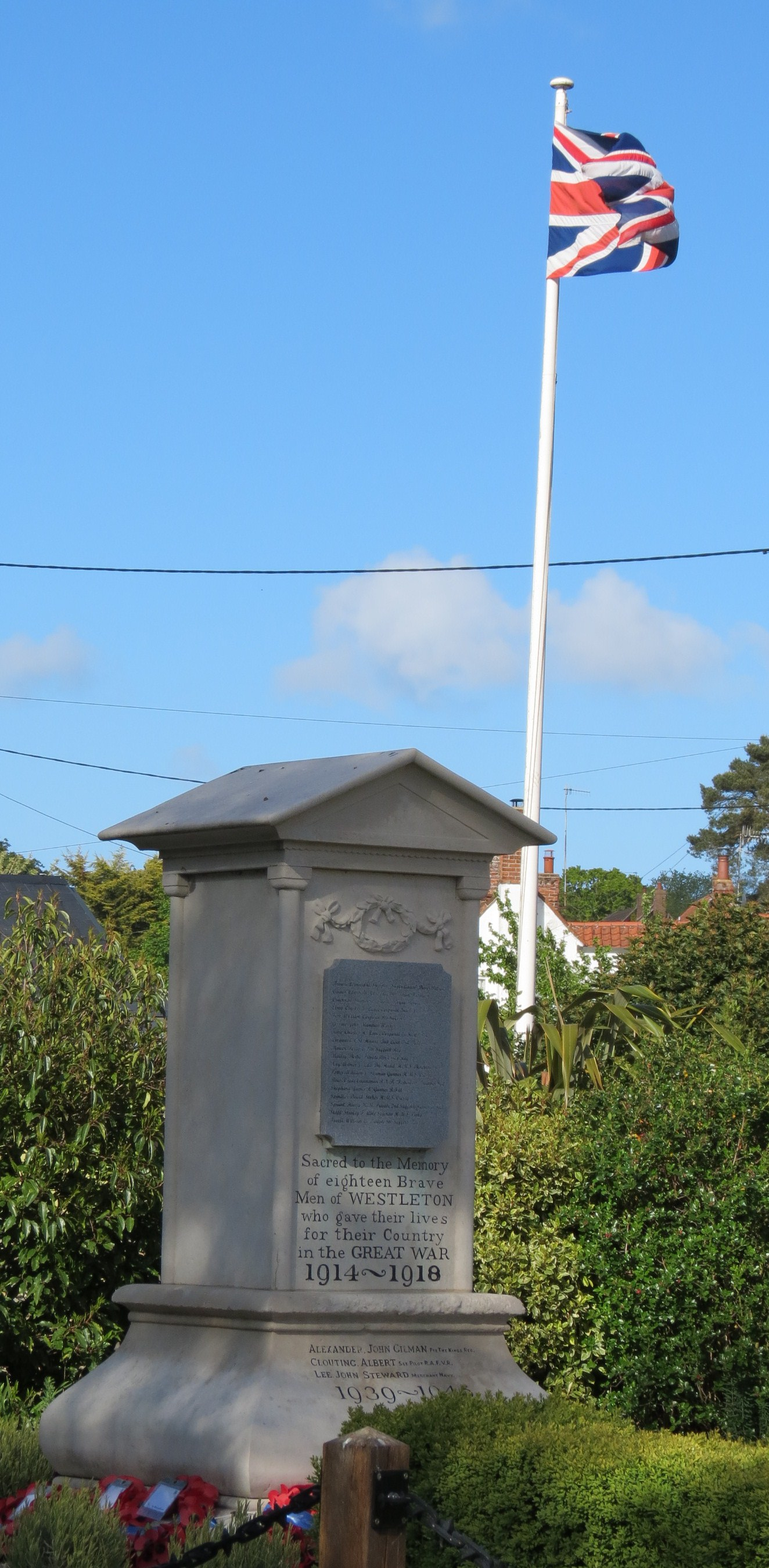War Memorial and Flag Pole with Union Flag in front of Westleton Village Hall